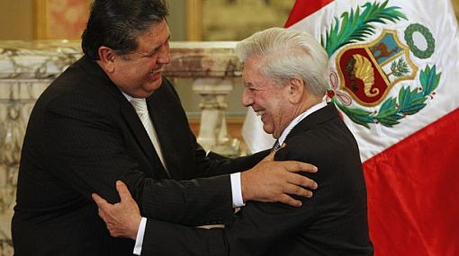 Peruvian-born Nobel Literature laureate Llosa embraces Peru's President Garcia after receiving the medal of Arts and Letters in Lima